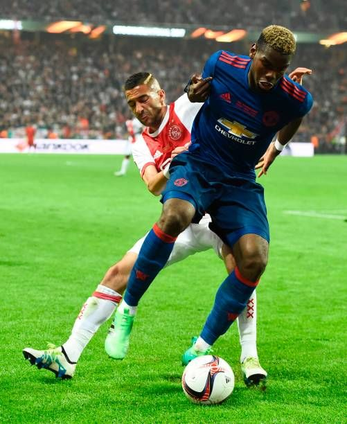 Ajax Moroccan midfielder Hakim Ziyech and Manchester United's French midfielder Paul Pogba vie for the ball during the UEFA Europa League final...