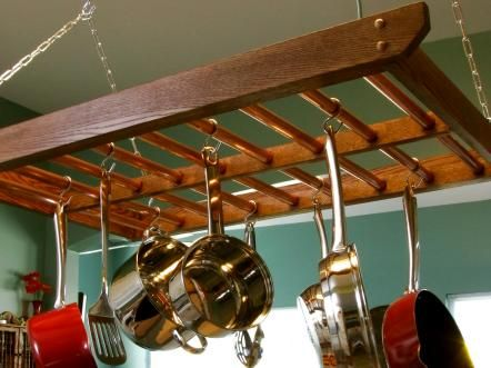 Pots and pans take up a lot of cabinet space. Hanging cookware on a rack suspended from the ceiling will free up a cabinet or two, and it will add more style to your kitchen.