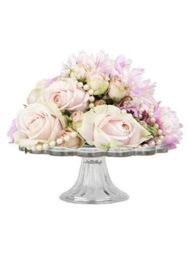 Click here to find out more!    Floral arrangements made on cake stands with pearls for extra detail create stunning centrepieces.    Cake stand flower arrangement, £65, Sweetpea Flowers (sweetpeaflowers.co.uk)