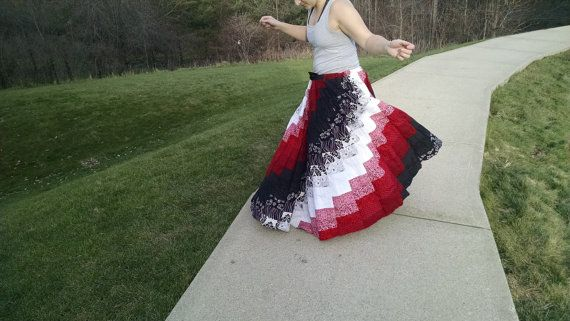 This one of a kind floor length skirt is a bargello patchwork spiral of many different shades of black, white, and red. The fabrics used are a mix of