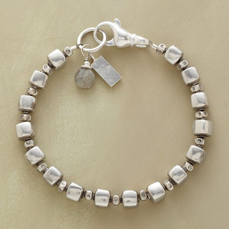 "CUBIST GARDEN BRACELET -- A sterling silver bead bracelet, in which flower-stamped beads flourish between cubes likewise handcrafted of sterling silver. A labradorite dangles at the lobster clasp. Exclusive. Made in USA. Approx. 7-1/4""L."