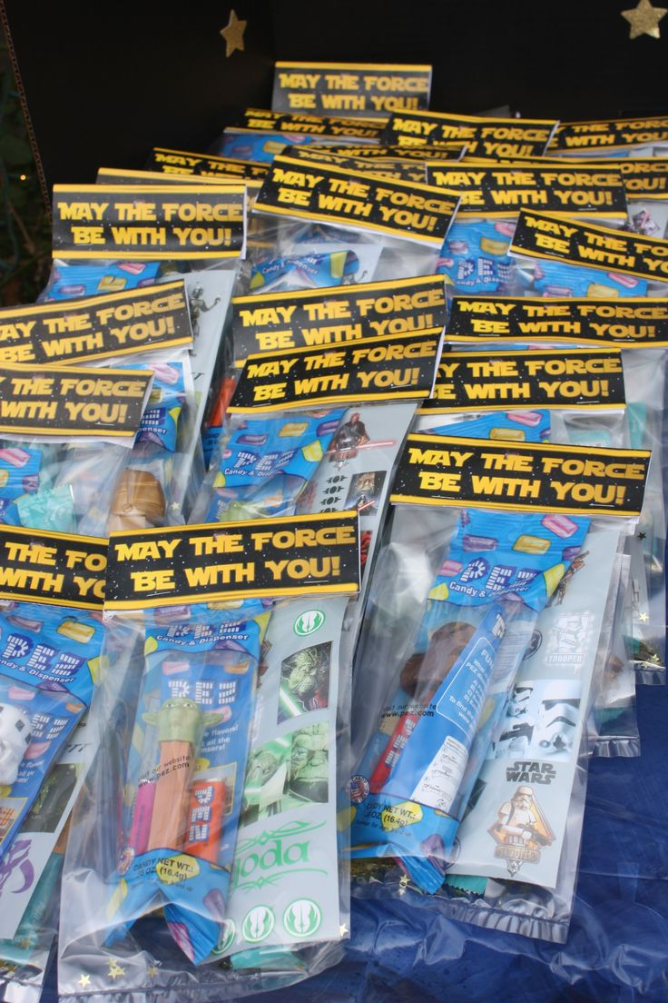 Star Wars Pez dispensers, stickers, fruit sticks, and little gold stars in the bags!  They turned out cute with the note stapled to the top!  Easy homemade favor bags.