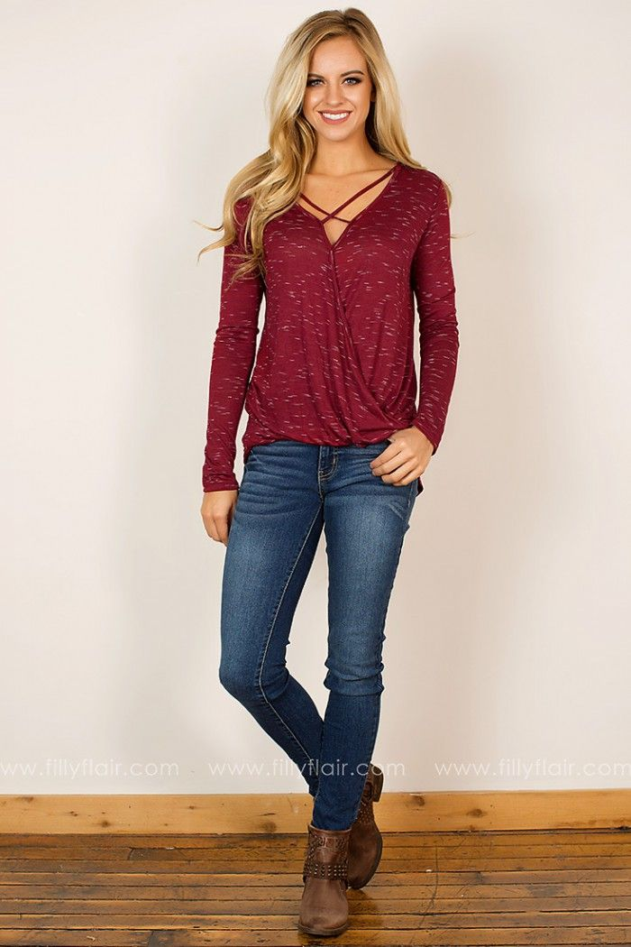 Check out this super cute long sleeve chic top! It features a beautiful drape front and criss-cross V-neck!