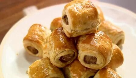Totally Lazy Mini Sausage Rolls  http://www.bbc.co.uk/food/recipes/totally_lazy_mini_98499