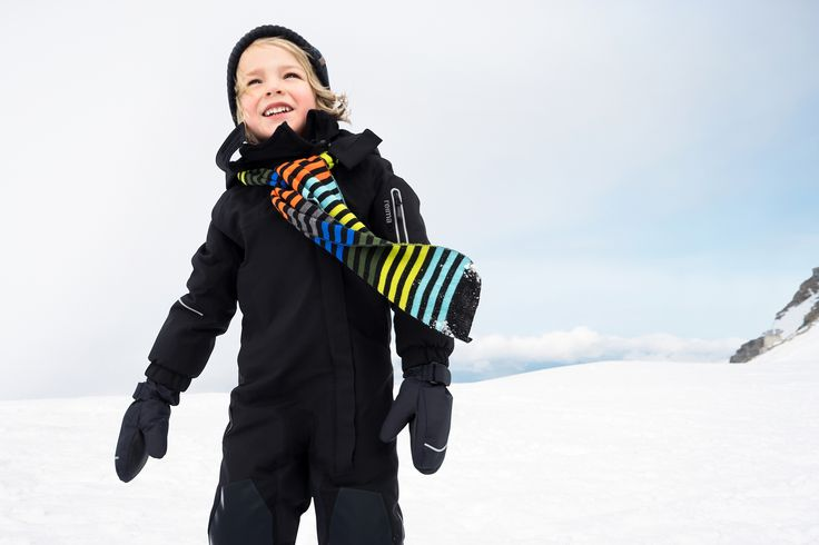 "Black Reima ""Vuono"" overall together with colorful ""Vuoret"" scarf is a perfect combination for winter play."