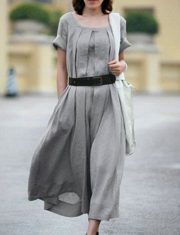 Grey linen dress with ballet neck, rolled sleeves and soft pleating