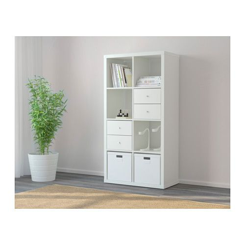 KALLAX Shelf unit - white - IKEA. Top shelf: decor; 2nd shelf: doors hiding linens, etc; 3rd shelf: Books; Bottom shelf: yellow fabric bins with toys