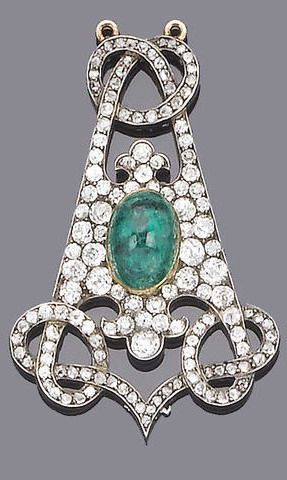 A 19th century emerald and diamond brooch/pendant The central collet-set oval cabochon emerald within a pavé-set old brilliant and rose-cut diamond tapered triangular panel with fleur-de-lys and interlocking scroll finials, old brilliant-cut diamonds approx. 2.25ct. total, brooch fitting deficient, length 5.5cm.