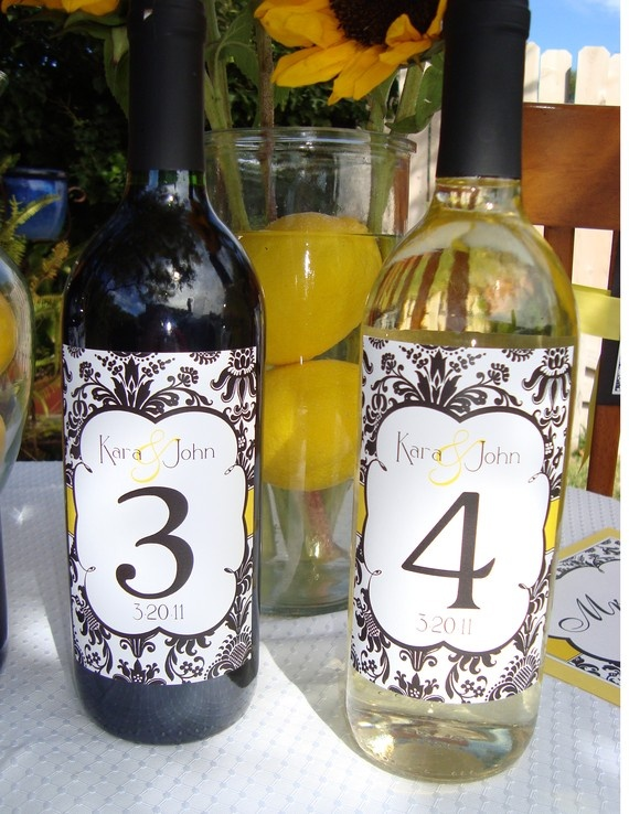 12 best images about wedding reception table decor on for Clear wine bottle centerpieces