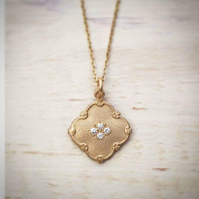 Artisan lucky button necklace