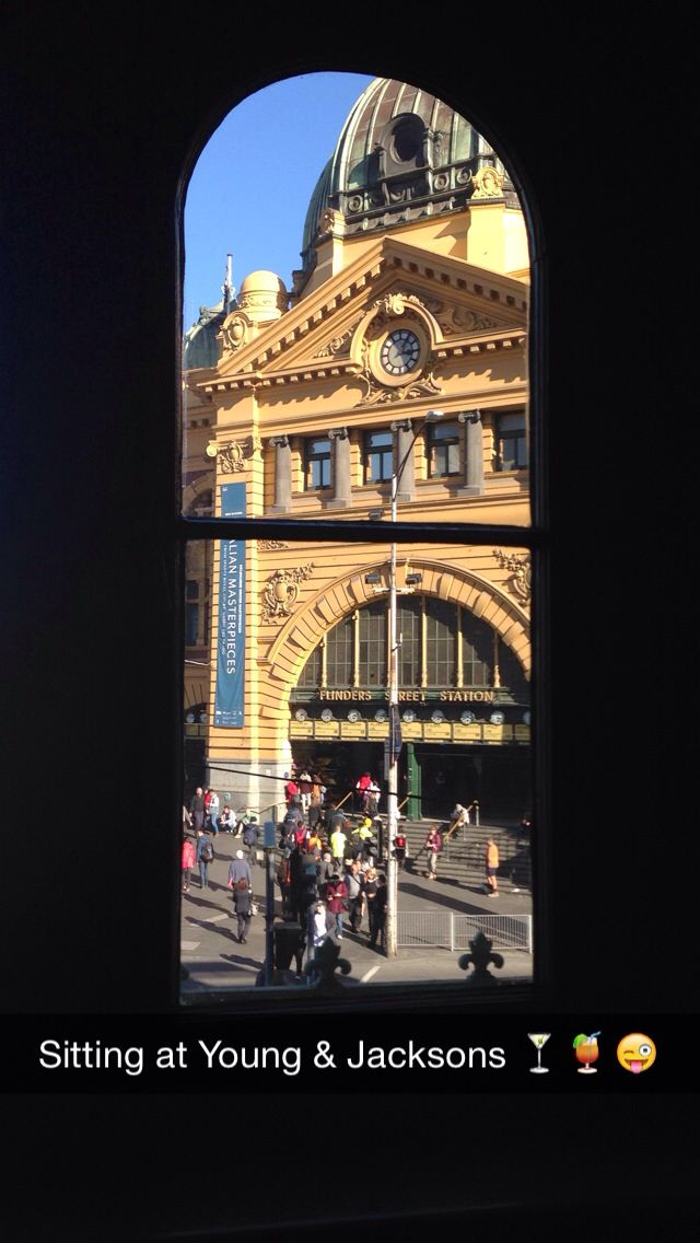 Flinders Street Station as seen through the window from the second story of Young & Jackson Pub - Melbourne, Australia