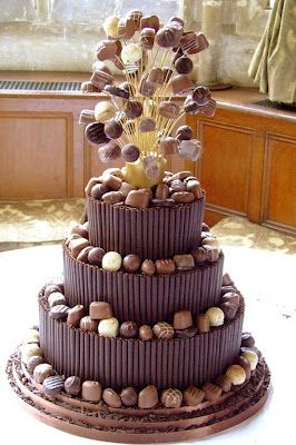 A chocolate truffle cake with chocolate pirouette cookies and a giant sugar and truffle cake topper! Cake designed by Hockley cakes