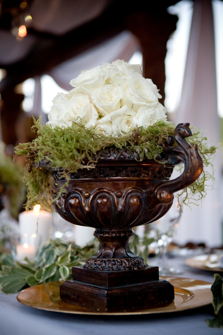 Roses and moss in an urn centerpiece — photo by april