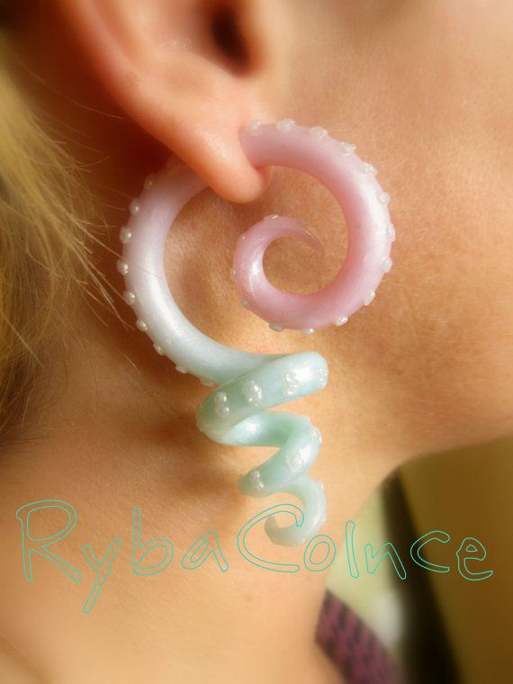 I have a mighty need for these. Fake ear tentacle gauges Faux gauge/Gauge by RybaColnce on Etsy, $28.00