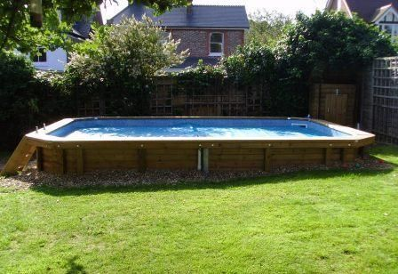 Swimming pools on sloped yards above ground pool on for Pool design for sloped yard