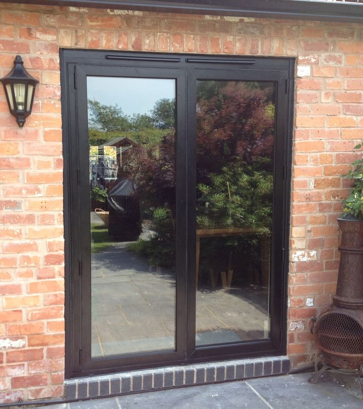 A Small Set Of Black Bi Folding Doors On A Garden Terrace Part 80