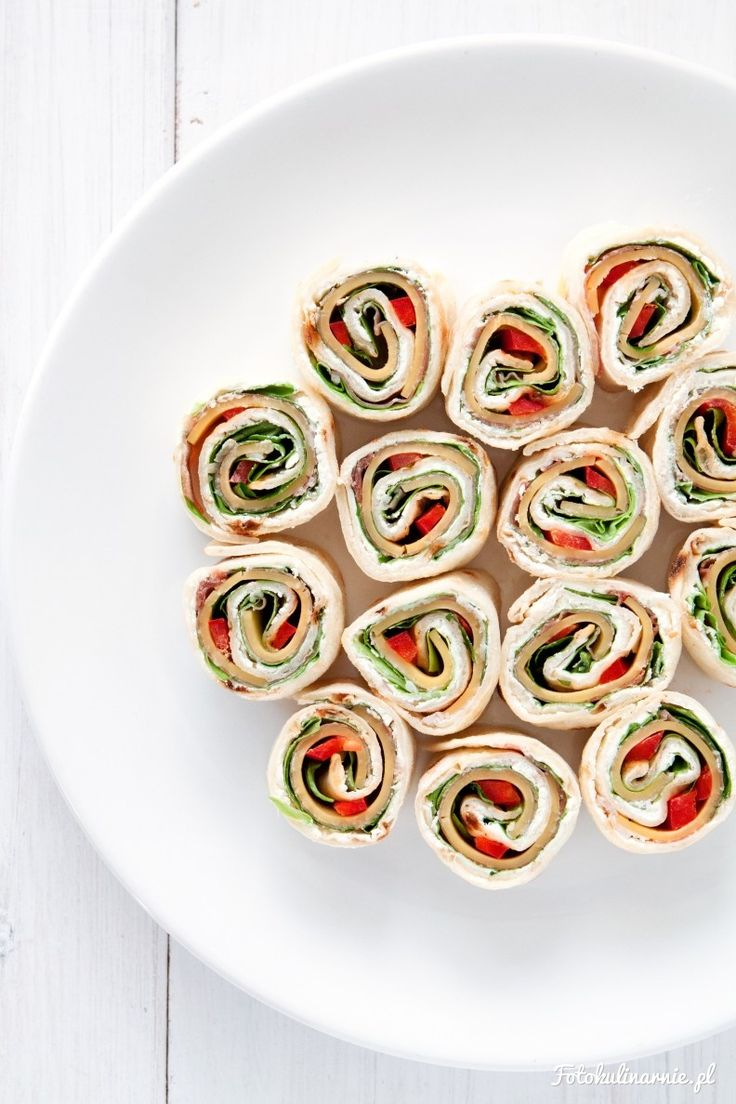 Mini wraps with prosciutto, cheddar, paprika, lettuce and cream cheese.