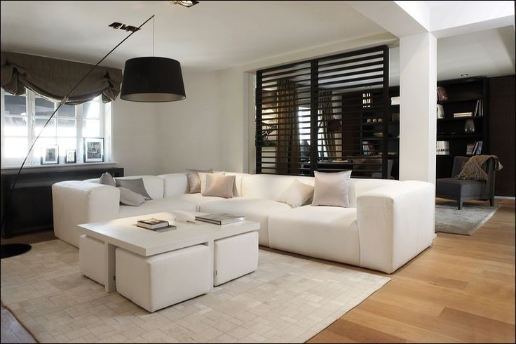 White living room. Interesting division.