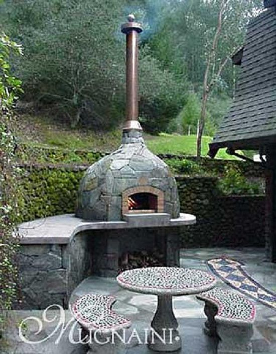 wood fired oven - with wood storage and built in counter top. I'd use a different cladding