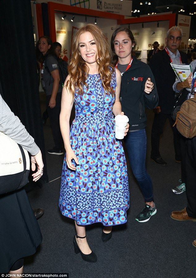 Isla Fisher was springtime chic on Thursday when she swung by the Jacob K. Javits Convention Center in the Hell's Kitchen area of Manhattan