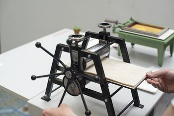 THE SMALLEST PRINTING COMPANY. Art installation featuring a very tiny hand made printing press.