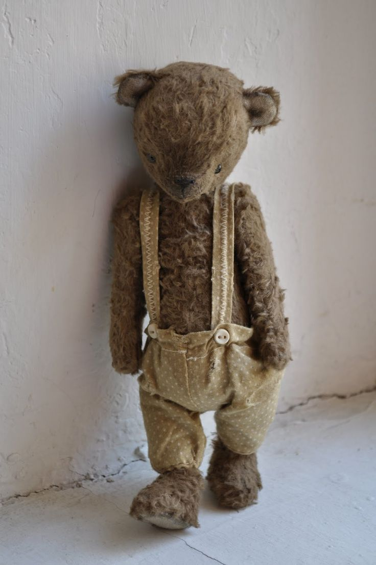old teddy...was worn' bare'! the twins slept together with him until they were 4 or 5....: