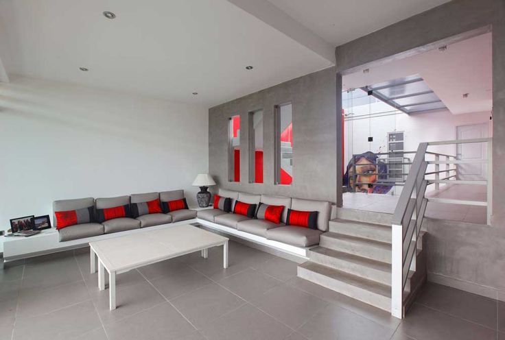 staircase ideas living room with staircase ceramic flooring tile with sofa red cushions plus white living table and recessed ceiling