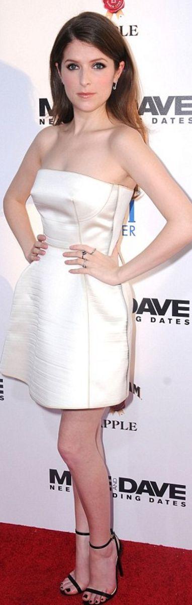 Anna Kendrick: Dress – Calvin Klein  Purse and shoes – Jimmy Choo  Bracelet – Le Vian  Ring – Maxior  Earrings – Anita Ko