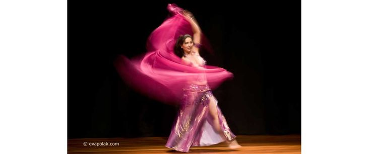 a belly dancer with a veil