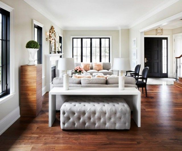 Black and white living room with wood floors and gray accents