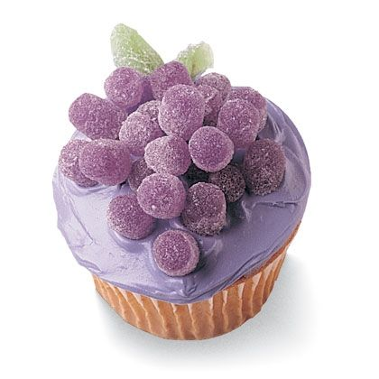 Grapes Cupcake--Decorated with purple gumdrops arranged in a grape-bunch shape and green gumdrop leaves.  Grape Kool Aid frosting would go great with the grape theme, too.