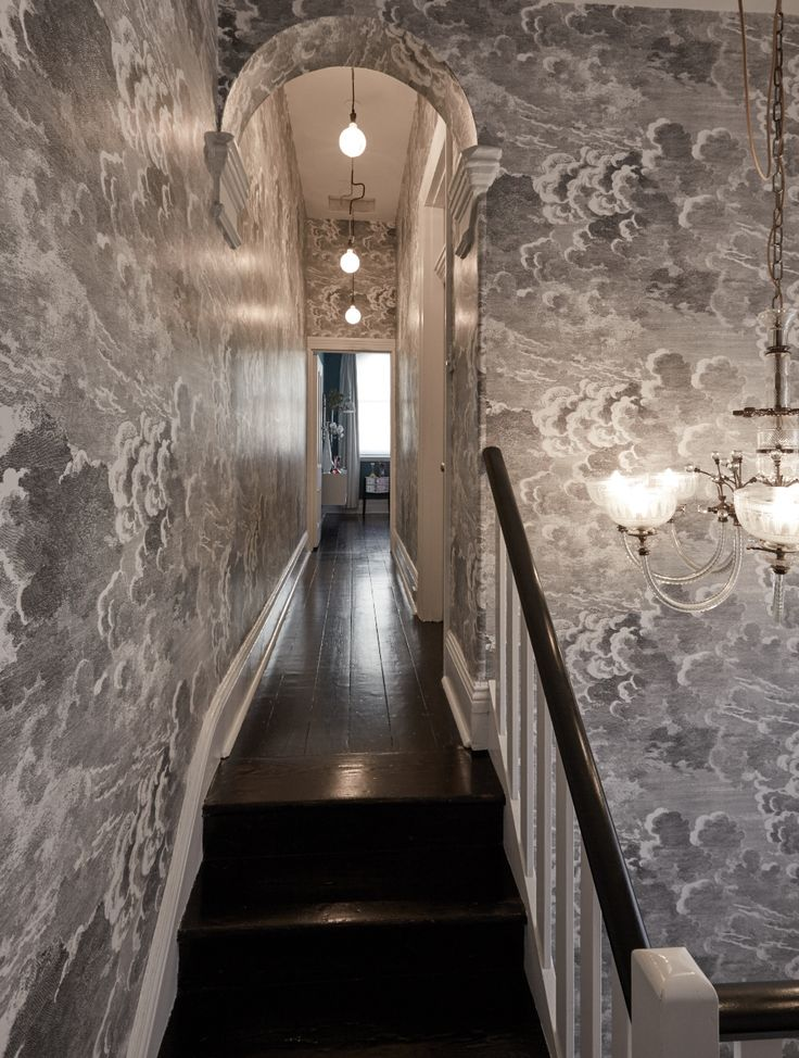 Foranasetti Nuvolette Cloud wallpaper with dark floor boards, antique chandelier and lights by Volker Haug