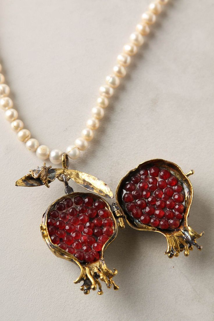 I love this pomegranate necklace... $298 from Anthropologie