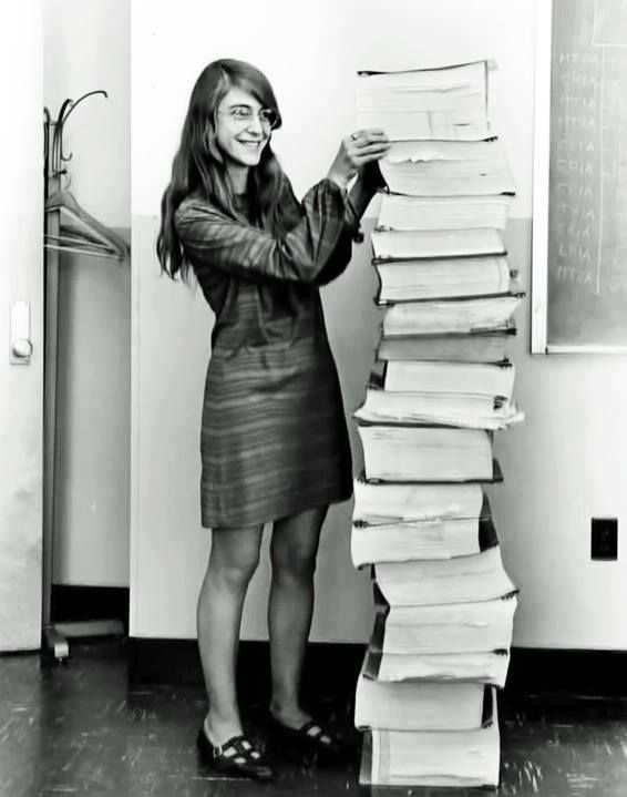 Margaret Hamilton, lead software engineer for the Apollo project with her code written by hand that took humans to the moon