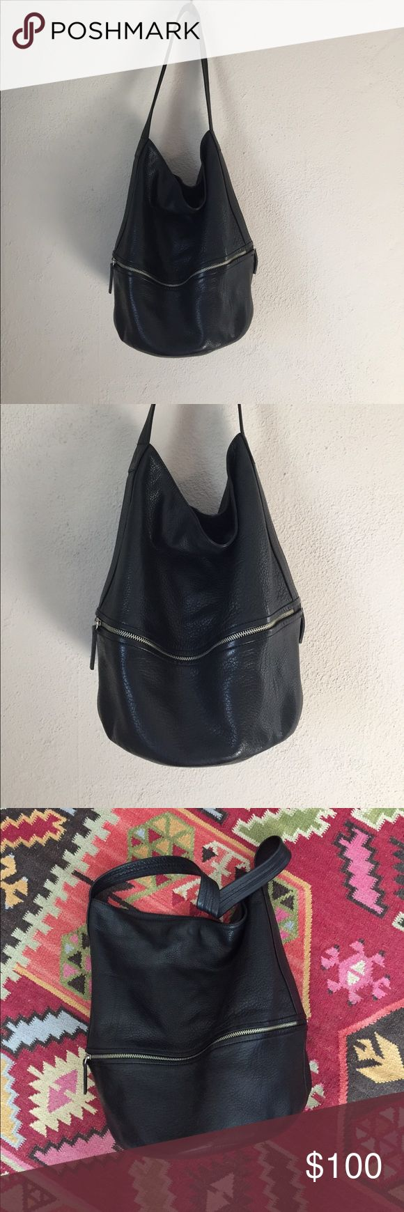 Hare + Hart Large Black Nappa Leather Bucket Bag Slouchy black pebbled large bucket bag from the label Hare + Hart. This bag is in good condition with a few minor scuffs but no large issues. Has some outer zip pockets and interior has some slots and another zip pocket. Interior is lined in cotton. Bag is about 15 inches from bottom to top. The diameter of the bottom is 10 in.  Please ask if you have any questions about the bag size. This is a larger version than what is currently on their…