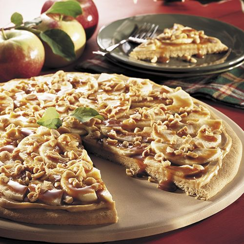 Taffy Apple Pizza - Sliced apples, caramel topping, and chopped peanuts top a giant sugar cookie to make this Pampered Chef classic.  Click here for the gluten-free version: http://www.pamperedchef.com/pws/kristenr/recipe/Desserts/Taffy+Apple+Pizza+%28Gluten-Free%29/585056