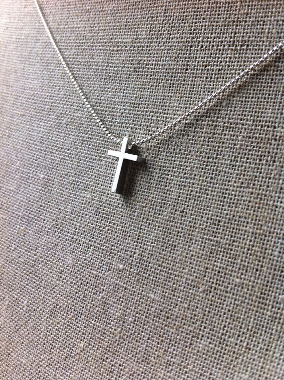 Small silver cross necklace by JillPickles on Etsy, $12.99. (Plain and small and perfect.)