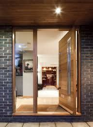 concept for wood door (not this handle or window in the door), side light and wood soffit with grey to create and warm, welcoming entrance