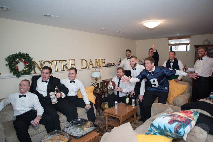 Notre Dame fall wedding. This is my favorite picture of the groom, groomsmen, and ushers getting ready before the wedding. Glad our wedding day did not come between the guys and the Notre Dame football game that was on. Thank you Contemporary Images for capturing this moment!