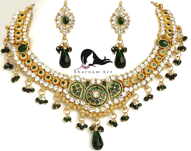 High quality designer piece.Contemporary design.High quality gems used.Carefully handset in sterling gold metal.DurableExcellent shine,finely cut and polished.Lays beautifully on your neck and ears TEAM IT UP:-Goes with a wide variety of ethnic garments like sarees, lehenga-choli,half-sarees,pawadais,salwar suits etc.Can be worn to any Indian function where you want to be dressed to kill. Dimensions: Width-12, Length-20, Height-3 cm