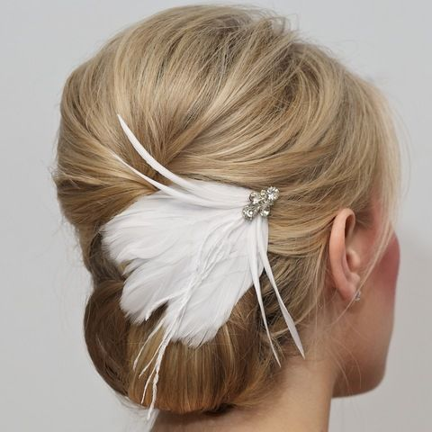 cute hair accessory :) hair is kind of plain for a wedding in my opinion but it's classy hair idk whatev lol