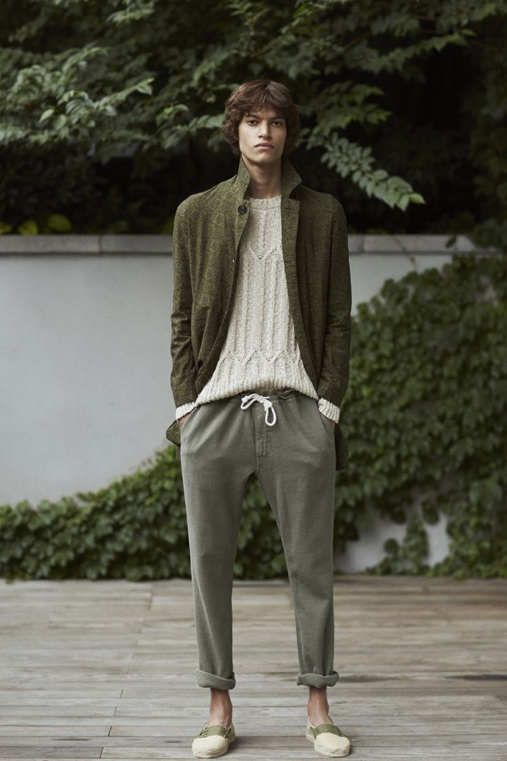 Look 9: (Mateo / Re:Quest) Army rustic printed Japanese shantung 'Shay' mac, sand cotton/linen broken cable crewneck sweater, army Japanese cotton/linen basketweave drawstring pants, natural espadrilles with army lace by Christian Kimber X Eidos Napoli.