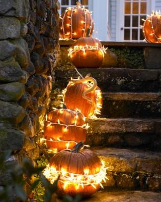 A great combination of two of my favorite decor items - pumpkins and string lights - and no messy carving.