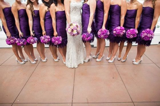 Deep purple bridesmaid dresses are paired with radiant orchid bouquets.  Flowers by Ingela Floral Design.  Wedding Venue: InterContinental The Clement Monterey. Photographer: Tim Halberg
