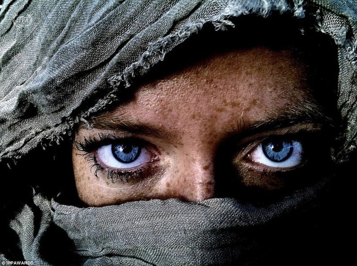 First place, People: Kim Hanskamp of Barcelona, Spain, took this captivating image of a blue-eyed woman, winning in the people category of the competition - on an iPhone.