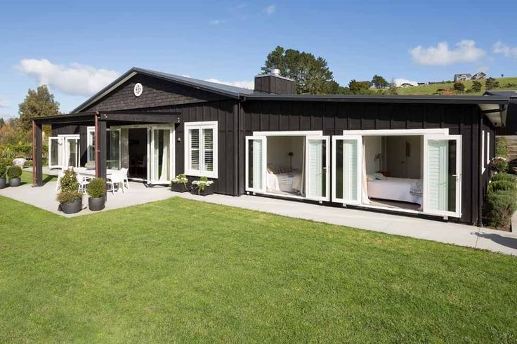 Matakana Design and Build - Painted board and batten exterior cladding...