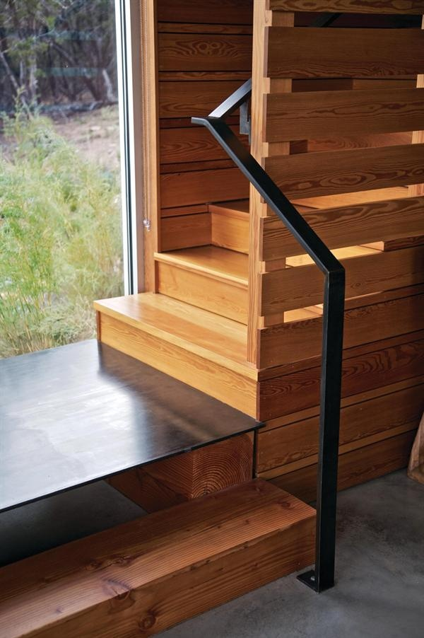 A metal plinth forms a small staircase landing.