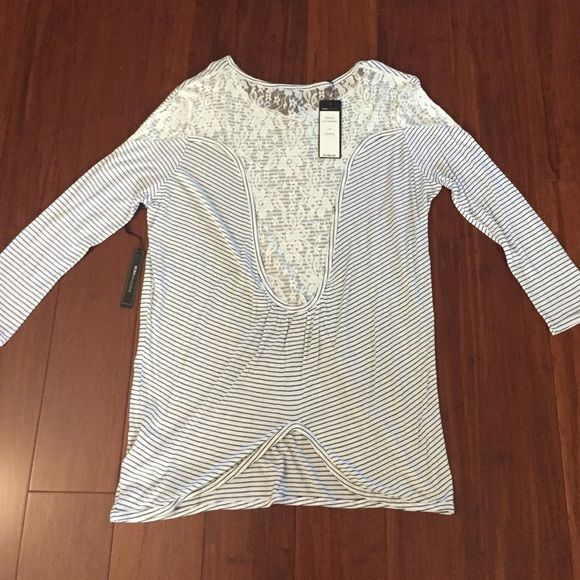 NWT BCBGMaxazria top Brand new with tags BCBGMAXAZRIA 3/4 sleeve top with laced back. Pairs well with leggings or skinny jeans. Super soft and comfy BCBGMaxAzria Tops Tees - Long Sleeve