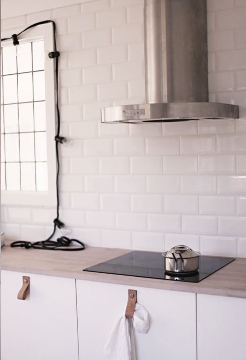 modern kitchen, white wall tiles, leather pulls
