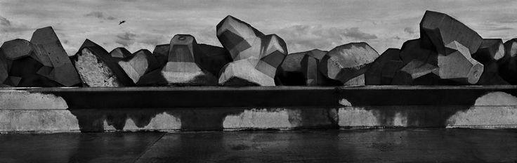 by Josef Koudelka - FRANCE. 1989. Region of Nord-Pas-de-Calais. City of Calais. The new harbour. Dyke.